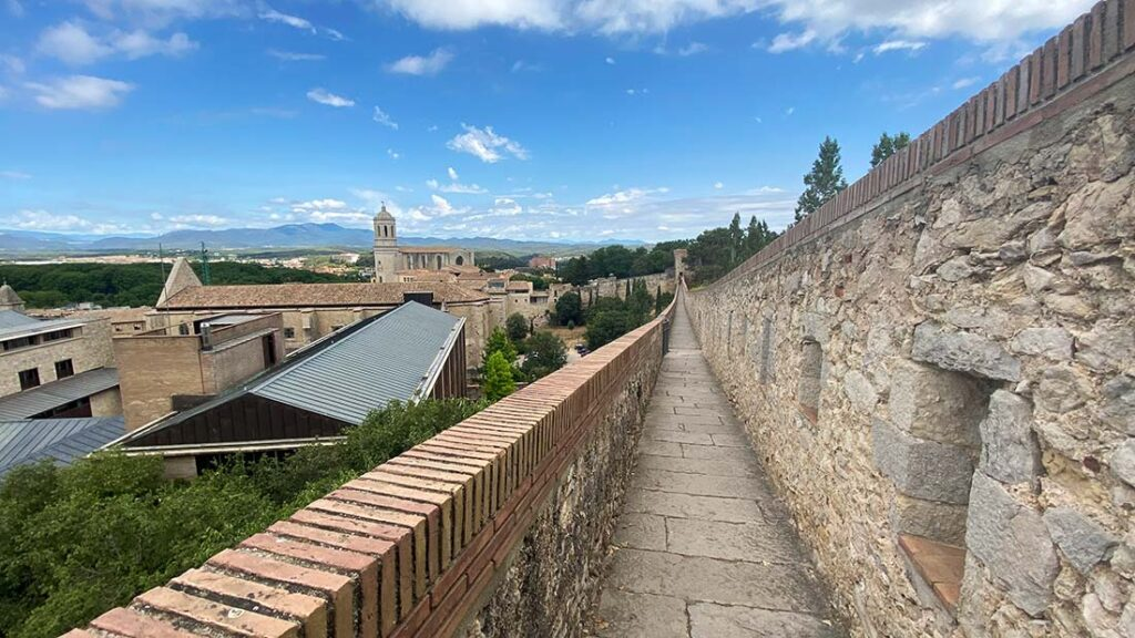 On a Day Trip from Barcelona to Girona, walk the historic city walls in this medieval town.