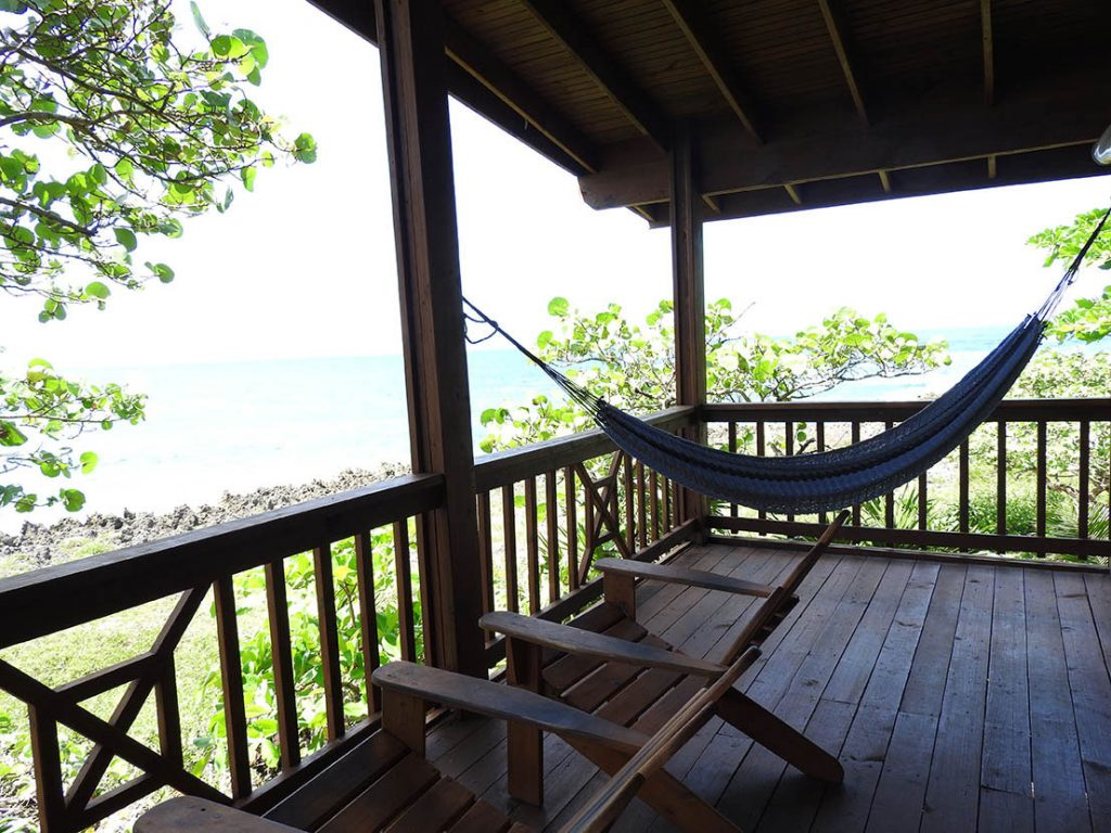Relax in a hammock on your balcony at Cocolobo Hotel on Roatan Honduras
