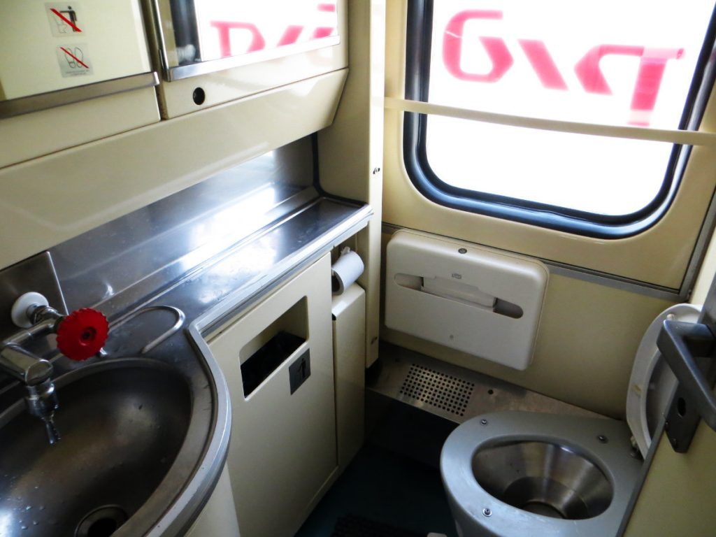 Bathroom on the Trans-Siberian Railway with a Toilet and Sink